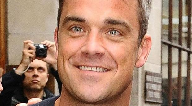 Robbie Williams is on course to top the albums chart