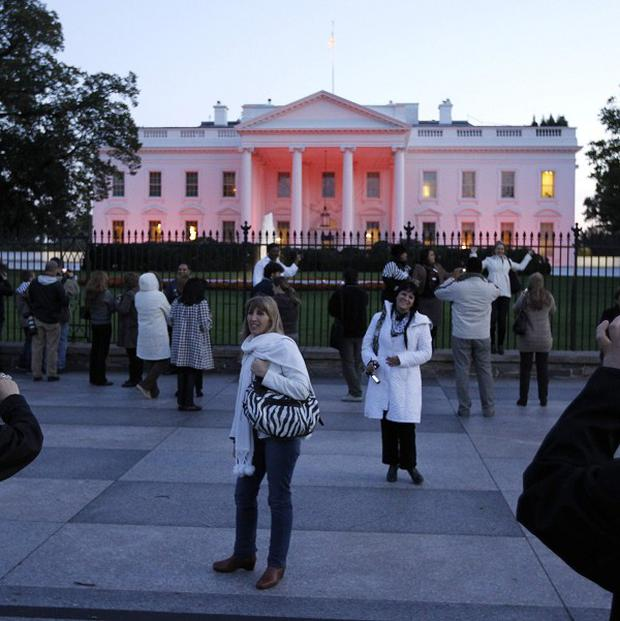 The White House is bathed in pink light in recognition of October as National Breast Cancer Awareness Month (AP)