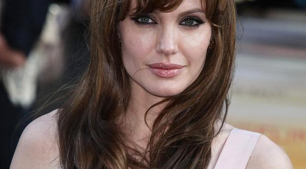 Angelina Jolie was set to start making her film, which she says is a love story