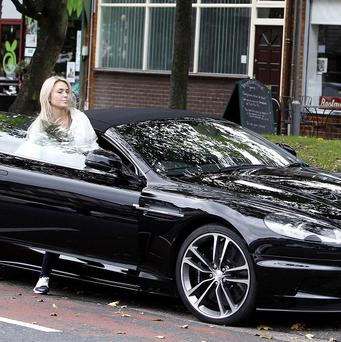 Alex Curran gets into her car before traffic wardens can issue her with a ticket for parking on a double yellow line in Liverpool