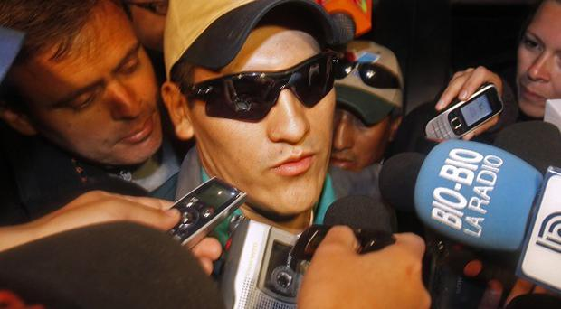 Rescued miner Carlos Mamani is surrounded by the press as he arrives home in Copiapo, Chile (AP)