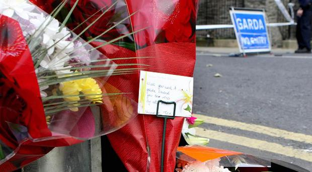 Flowers left on Castle Road in Dundalk, where 18-year-old Niall Dorr was involved in a fight on Wednesday night. He later died in hospital
