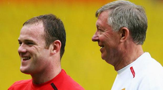 Wayne Rooney with manager Sir Alex Ferguson pictured in May 2010