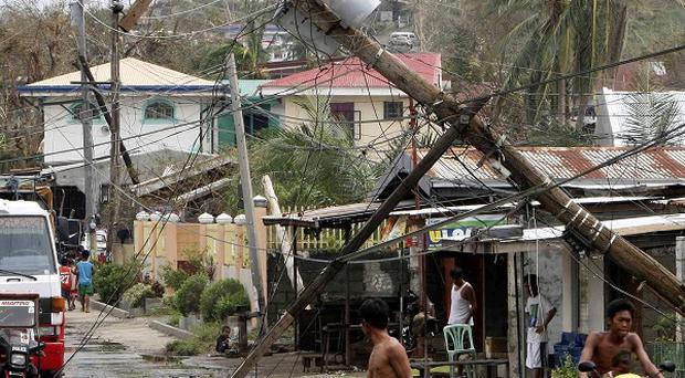 An electric pole remains leaning at Ilagan township after typhoon Megi hit Isabela province in the north-eastern Philippines (AP)