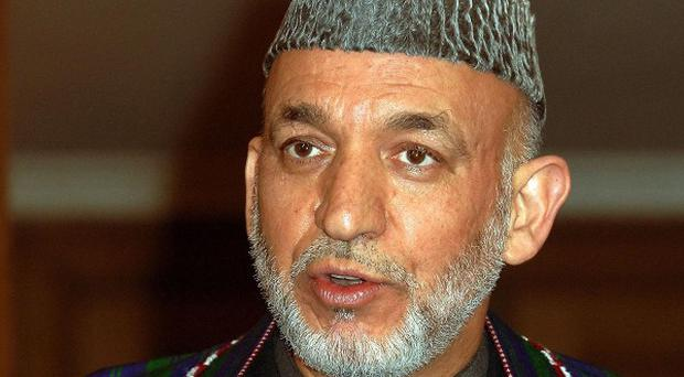 Hamid Karzai's government has been holding secret talks with a Taliban group, a source said