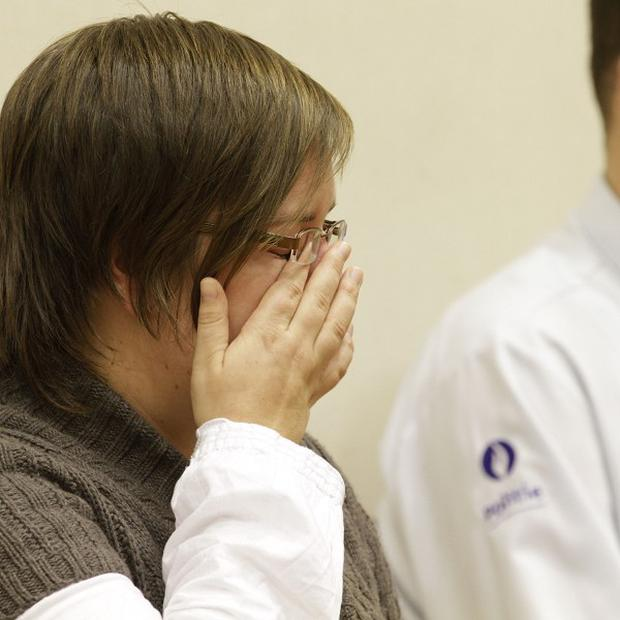 Els Clottemans wipes a tear as she is found guilty of murder. (AP)