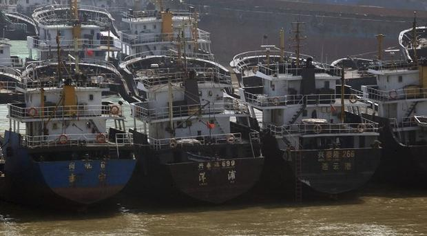 Ships have been docked at a port in Haikou, in south China's Hainan province, before the arrival of Typhoon Megi