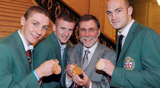 Sports Minister Nelson McCausland meets Shaun Downey (bronze medal cyclist), Paddy Barnes, (gold medal boxing) and Steven Ward (silver medal boxing) at a special reception in Parliament Buildings