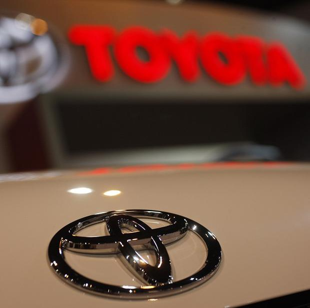 Toyota is recalling 1.53m cars for brake fluid and fuel pump problems (AP)