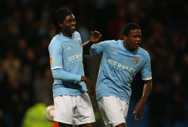 MANCHESTER, ENGLAND - OCTOBER 21: Emmanuel Adebayor of Manchester City celebrates his third goal with Dedryck Boyata during the UEFA Europa League Group A match between Manchester City and KKS Lech Poznan at City of Manchester Stadium on October 21, 2010 in Manchester, England. (Photo by Stu Forster/Getty Images)