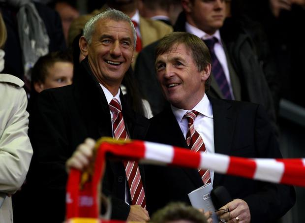 LIVERPOOL, ENGLAND - APRIL 29: Ian Rush shares a joke with Kenny Dalglish (R) prior to the UEFA Europa League Semi-Final Second Leg match between Liverpool and Atletico Madrid at Anfield on April 29, 2010 in Liverpool, England. (Photo by Clive Brunskill/Getty Images)