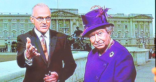 The Queen on the weather forecast with Frank Mitchell during her visit to The UTV studio. October 2010