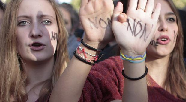French students hold up their hands painted with 'No' during a protest in Paris (AP)