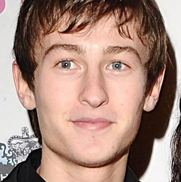 Actor Elliott Tittensor has been charged with driving without insurance after an accident in north London