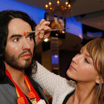 Russell Brand's wax figure at Madame Tussauds, London, is being painted with a tilaka prior to his wedding in India