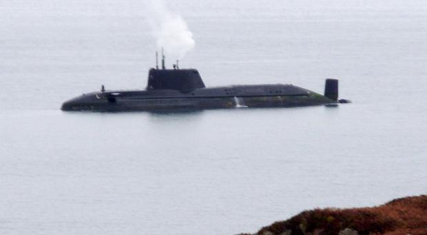 Efforts are under way to free HMS Astute after it ran aground off the coast of the Isle of Skye