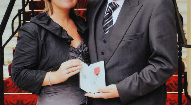 John Harrison and wife Mandy after receiving MBE