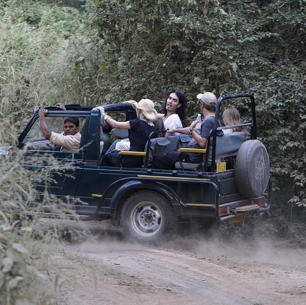Russell Brand sits with others in a jeep during a jungle safari at the Ranthambore National Park in India (AP)