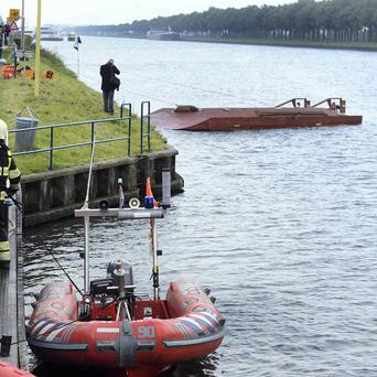 Rescue workers near a capsized ferry near Amsterdam (AP)