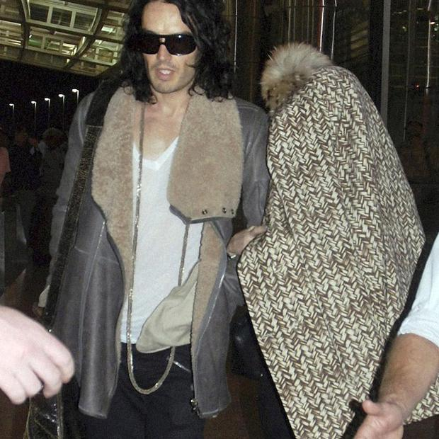 Russell Brand's bodyguards were accused of attacking photographers