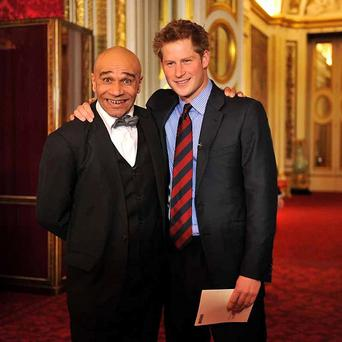 Goldie with Prince Harry. A group formed by the musician performed at a special concert at Buckingham Palace