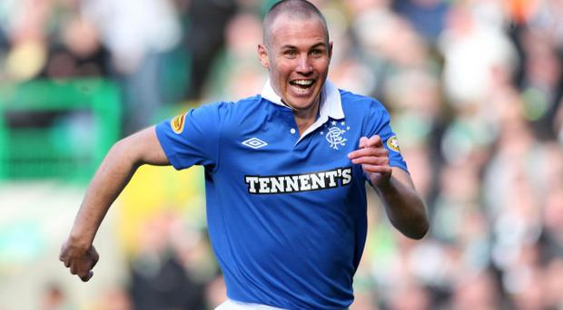 Rangers Kenny Miller celebrates scoring the second goal during the Clydesdale Bank Scottish Premier League match at Celtic Park, Glasgow