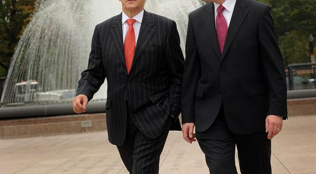 Peter Robinson (right) and Martin McGuinness will meet Prime Minister david Cameron to discuss spending cuts