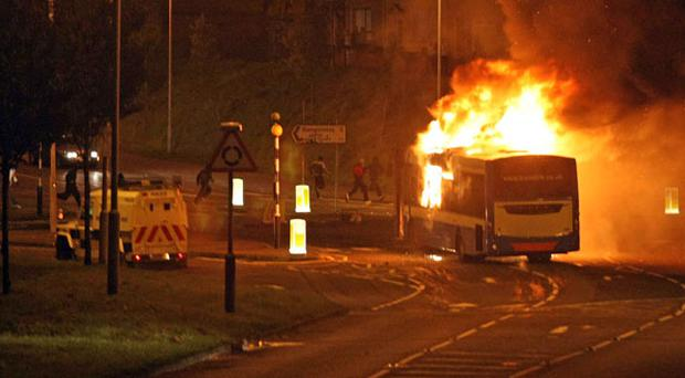 PSNI arrive at Cloughfern Corner as a second night of violence erupts