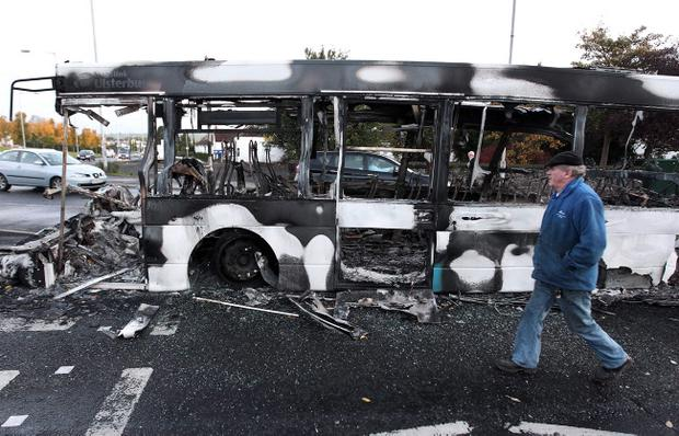 The debris of a burnt out bus at a roundabout outside the Rathcoole estate in north Belfast. October 27 2010