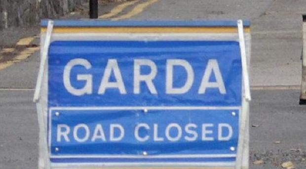 A man died after his motorbike and a car collided, gardai said