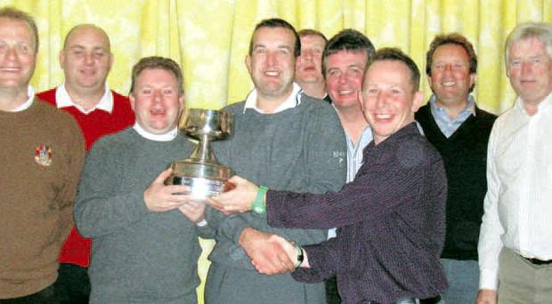 Read all about it: Fortwilliam's Gary Currie and Martin Colohan receive the Belfast Telegraph Foursomes trophy from Gary Posnett. Included are member of the other teams in the final, Donaghadee, Lurgan and Blackwood