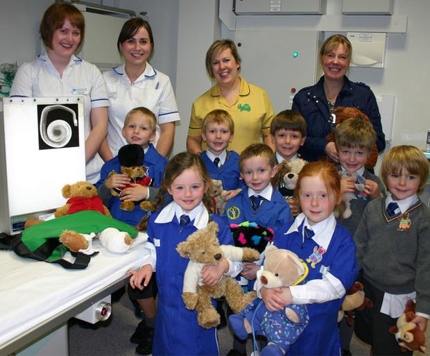 Pupils from Connor House Pre-school, Bangor, had a Well Teddy Clinic at the Ulster Hospital. Joining them were (back row): Fiona Little (Radiographer), Lindsay Hanna (Radiographer), Jane-Marie Gilmore (Play Specialist) & Heather Lyle (Connor House)