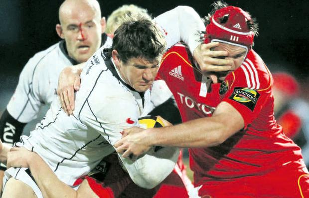 All in the eyes: Ulster's Robbie Diack is tackled by Munster's Billy Holland at Ravenhill last night