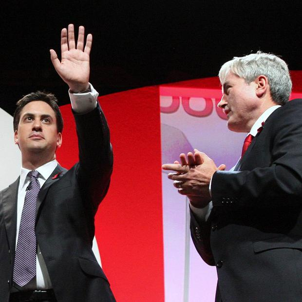 Iain Gray applauds Ed Miliband after the new party leader made his first speech to the Scottish Labour conference in Oban