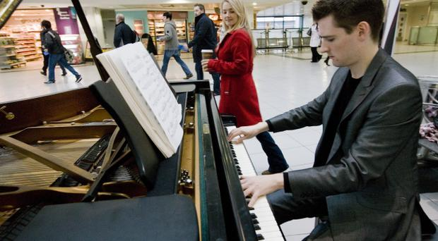 Extended Caption15 October 2010Rail passengers revel in sounds of ChopinAs part of Translinks Rail Nights Out campaign, the public transport provider today (15th October) joined forces with the Belfast Festival to celebrate the 200th anniversary of world -renowned pianist and composer, Fryderyk Chopin, with an intimate tribute from two of Northern Irelands up and coming musicians at Belfasts Central Station.Running from 1st September to 30th November, the Rail Nights Out initiative is designed to encourage the Northern Ireland public to get out and about in the evenings by train and try something different. During the campaign, passengers can take advantage of a third off the cost of a standard day return train ticket when travelling on any Translink NI Railways service after 9:30am - as well as availing of discounts at various restaurants, cinemas, entertainment venues and the Belfast Festival at Queens where passengers can benefit from discounted ticket prices for selected performances.For further information on Rail Nights Out and Translink fares passengers can pick up a leaflet in Translink stations, contact the call centre on 028 9066 6630 or log on to www.translink.co.uk. Pictured: Passengers take a break from the rush hour madness and enjoy sounds of Chopin as Michael McHale from Belfast provides a taster of whats on offer from a Translink Rail Night Out. Ends For further information please contact Nicola Adamson /Sarah Stitt at Morrow Communications on 02890393837/07792162685 or email n.adamson@morrowcommunications.com