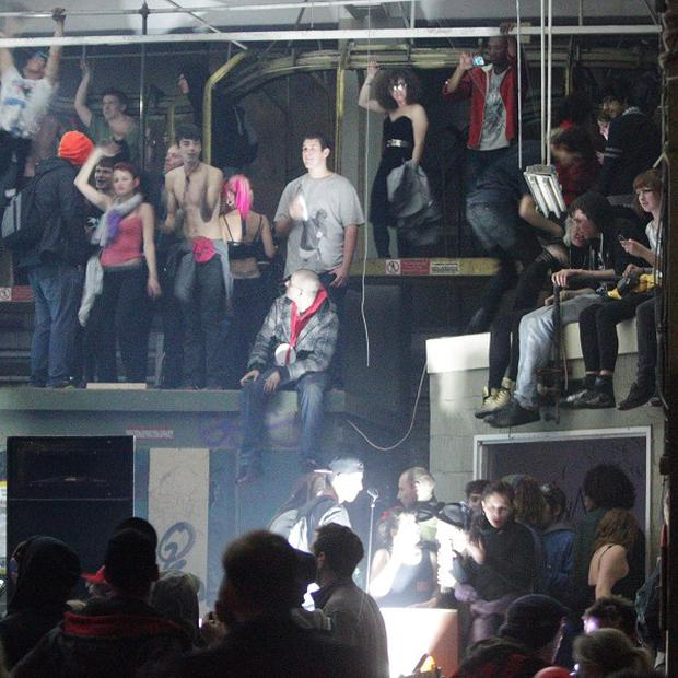 Revellers inside the suspected illegal rave in Museum Street, central London