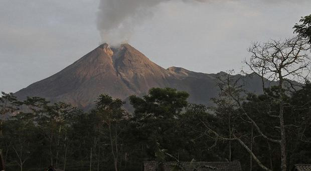 Mount Merapi spews volcanic smoke as seen from Deles, Central Java. (AP)