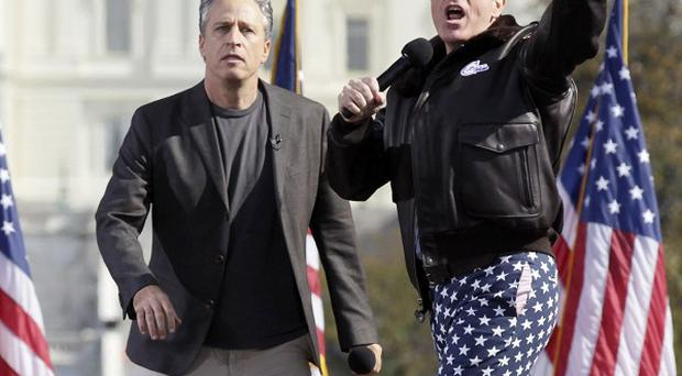 Comedians Jon Stewart and Stephen Colbert have entertained thousands at a 'sanity' rally in Washington (AP)