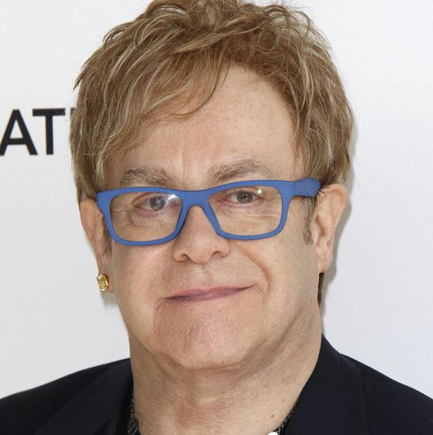 Sir Elton John will step into the breach and perform at his Aids fundraiser after singer Lily Allen pulled out due to illness