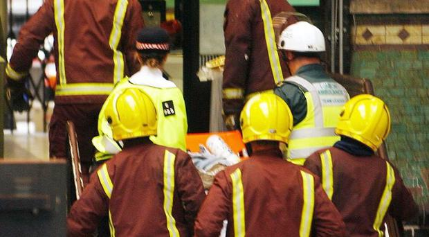 London firefighters bring up the seriously injured at Aldgate tube station on July 7, 2005, after Shehzad Tanweer detonated his bomb