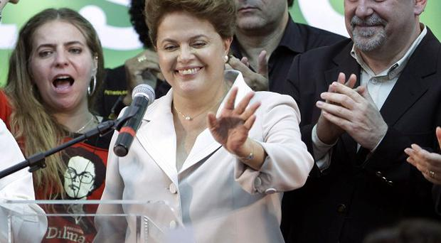 Dilma Rousseff waves to supporters as she arrives to give her victory speech (AP)