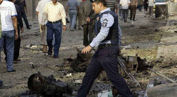 An Iraqi policeman near the Catholic Church in Baghdad after security forces stormed the building