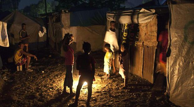 Earthquake survivors living in Haiti said there was little they could do to protect themselves from Tropical Storm Tomas
