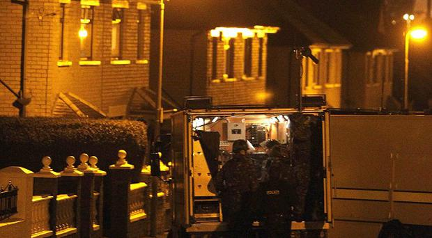 Army technical officers arrive at the scene of a suspected bomb in West Belfast (AP)