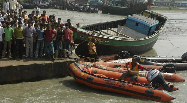 Rescue workers recovered 69 bodies three days after a boat toppled into the Hooghly River in West Bengal, India (AP)