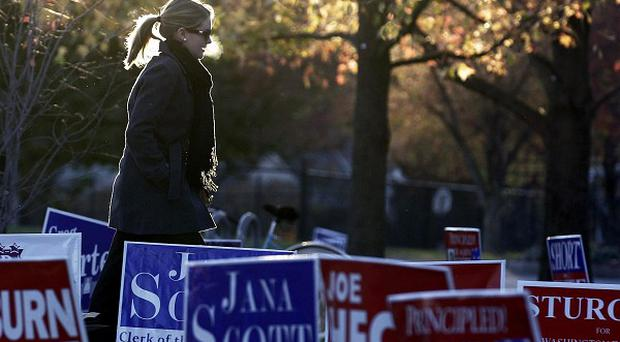 A US voter arrives at the polls to cast her vote in the Indiana elections (AP)