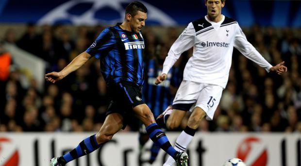 LONDON, ENGLAND - NOVEMBER 02: Lucio of Inter Milan passes the ball as Peter Crouch of Spurs closes in during the UEFA Champions League Group A match between Tottenham Hotspur and Inter Milan at White Hart Lane on November 2, 2010 in London, England. (Photo by Clive Rose/Getty Images)