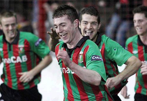 Glentoran supersub Matty Burrows celebrates his wonder goal at the Oval