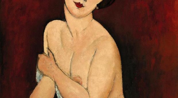 La Belle Romain by Amedeo Modigliani sold at Sotheby's in New York for 43 million pounds (AP)