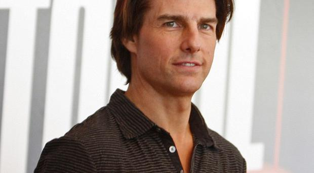 Tom Cruise dangled from the world's tallest building while filming Mission: Impossible in Dubai